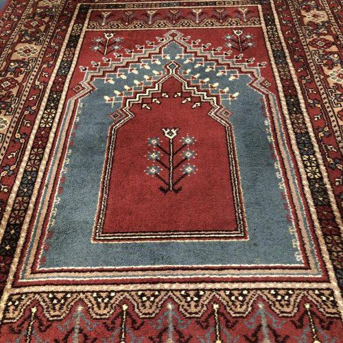Perzisch kleed met blauw tempel motief